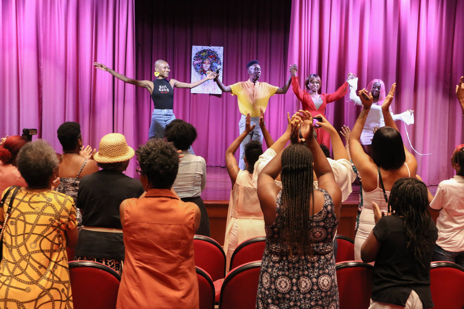 The performers and organizer Chris Banks, second from left, received a standing ovation after their performances.
