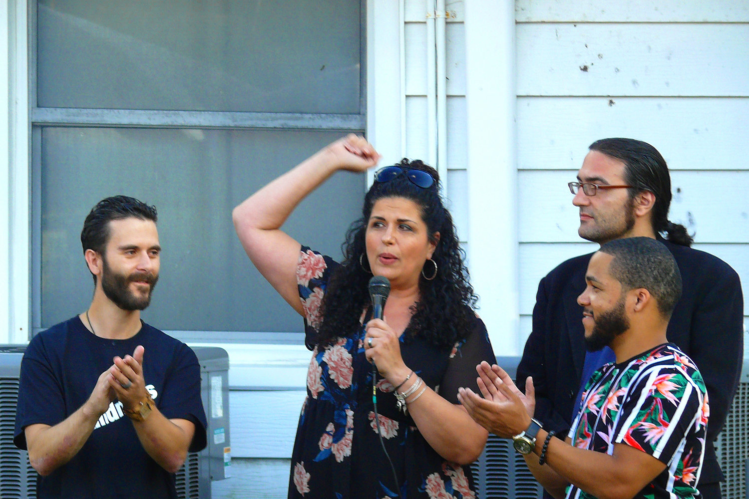 Gina Centauro, one of the founders of Rescuing Families Inc., told the crowd last Saturday that every dollar they spent at the fundraiser would benefit families in need. She was with, from left, Vincent Centauro, Roger Grand-Pierre and Michael Cantone.