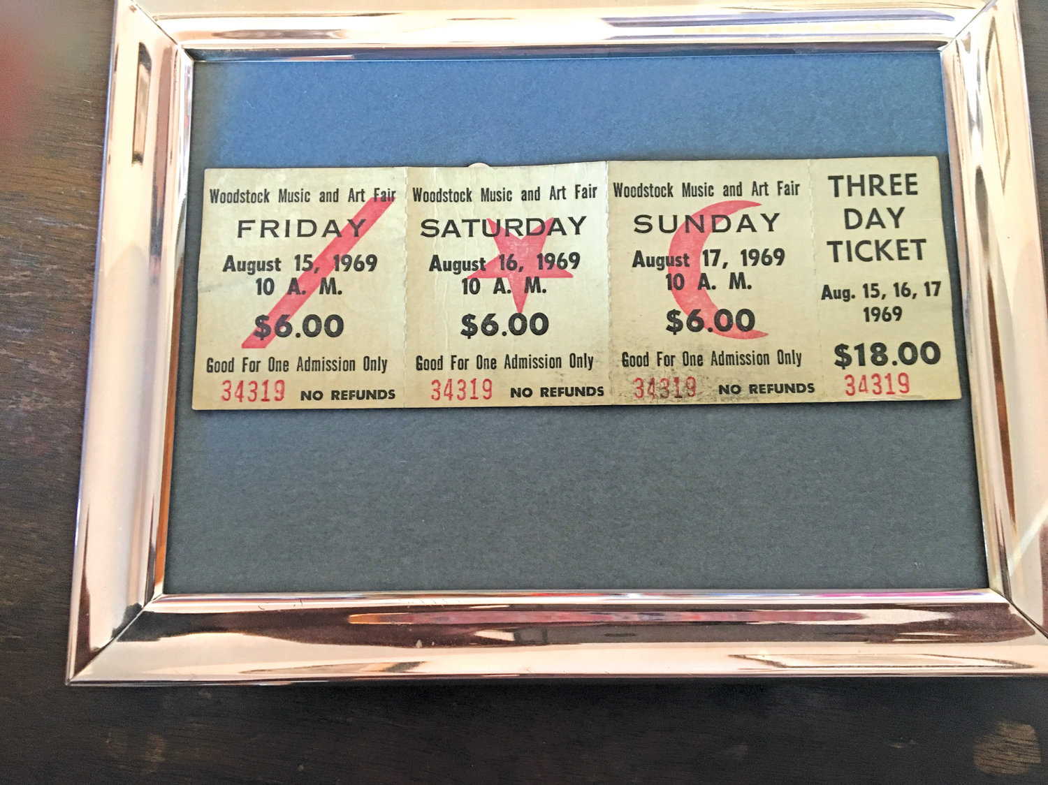 Oceanside resident Bernie Hirschhorn keeps his original Woodstock tickets framed on a wall in his home.