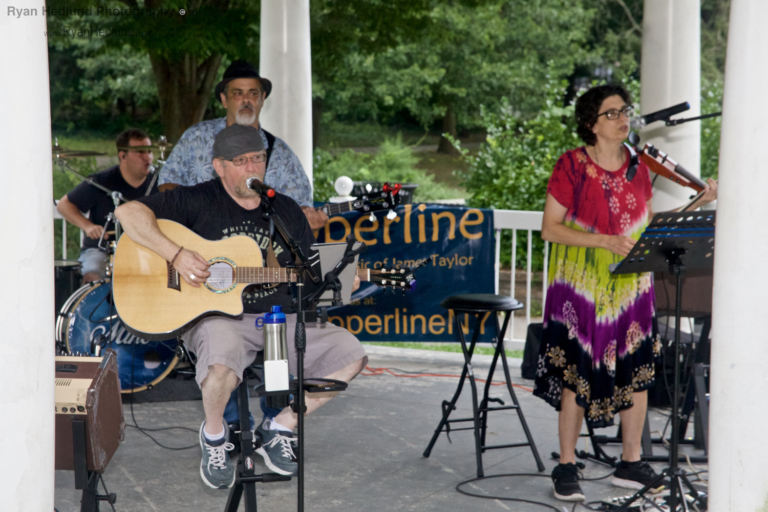 """Copperline,"" a James Taylor Tribute Band, performed under the gazebo at Hall's Pond Park in West Hempstead on Aug. 18."
