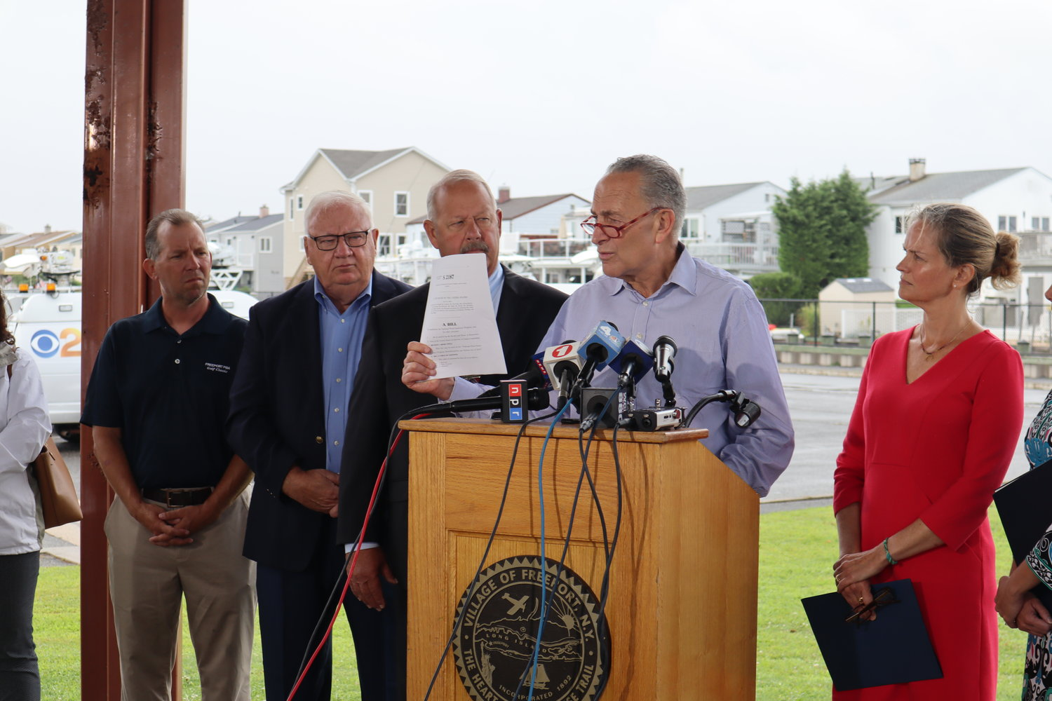 Sen. Charles Schumer introduced his flood insurance reform bill at a news conference in Freeport on Wednesday. With him, from left, were Freeport Trustee Christopher Squeri, Freeport Mayor Robert Kennedy, County Executive Laura Curran and Hempstead Town Supervisor Laura Gillen.