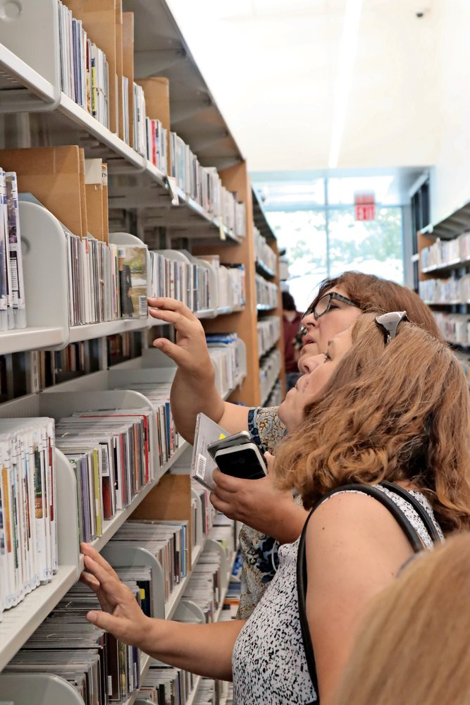As soon as guests were allowed in the library, they began perusing the shelves.