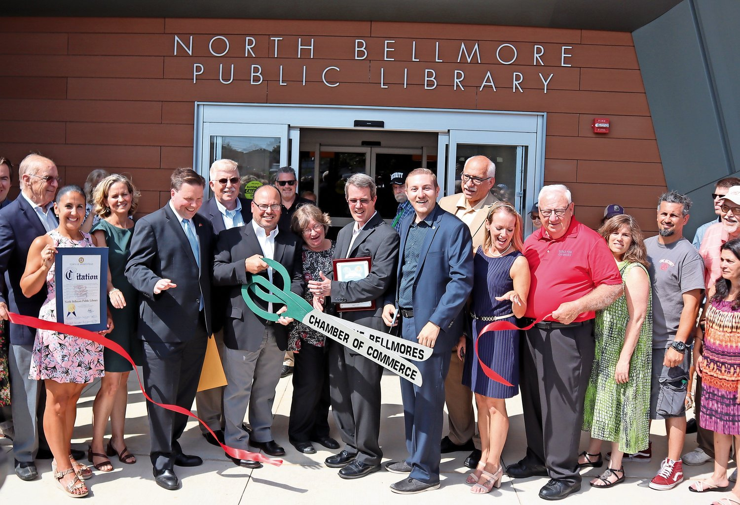 A hot sun didn't crimp the enthusiasm of the elected officials, Chamber of Commerce members, library trustees and library staffers who took part in the ribbon-cutting.