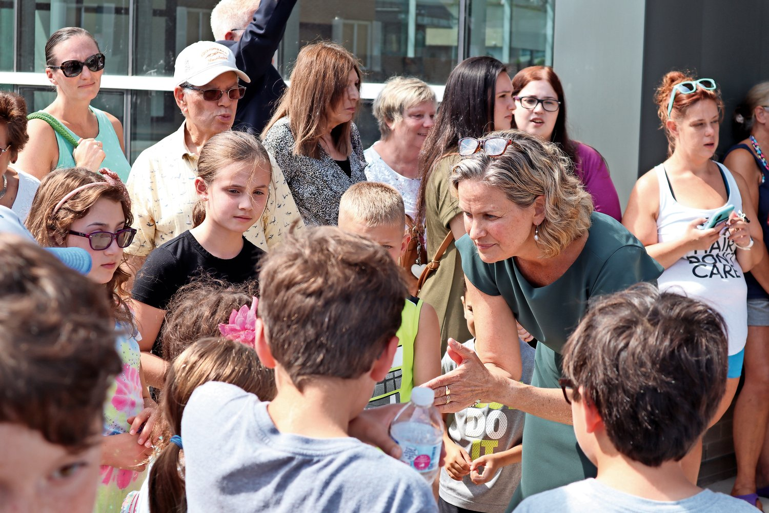 Nassau County Executive Laura Curran chatted with children outside the library.