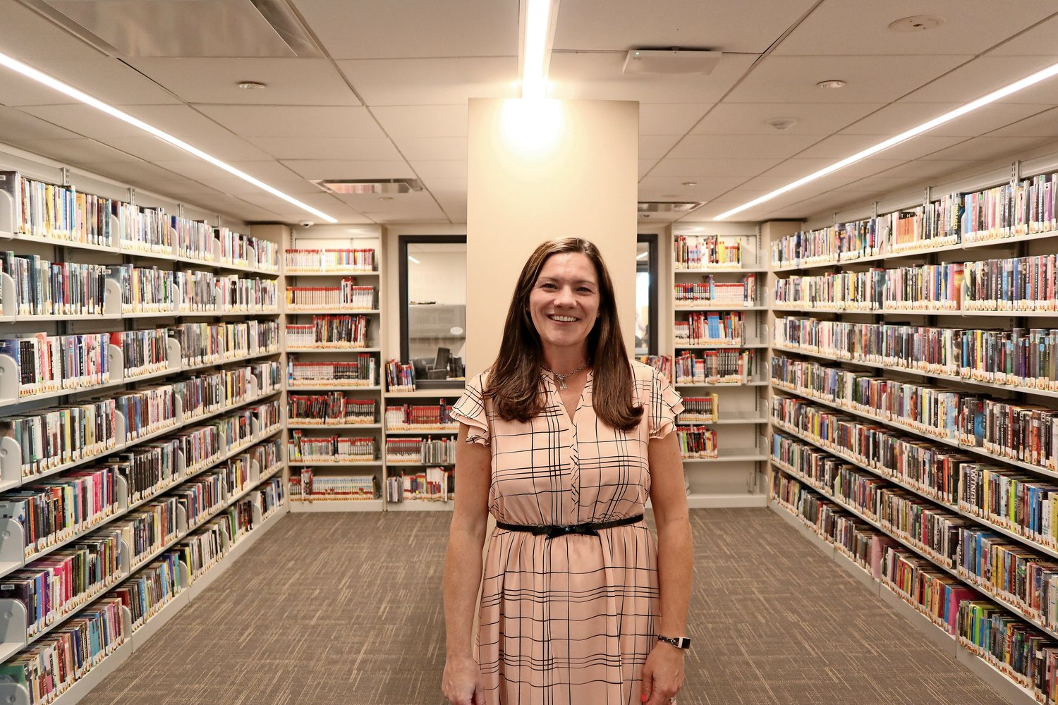 Jessica Tymecki, head of the young adult department, in her corner of paradise. When Bazzicalupo retires, she will become the acting librarian in charge during the search for a new director.