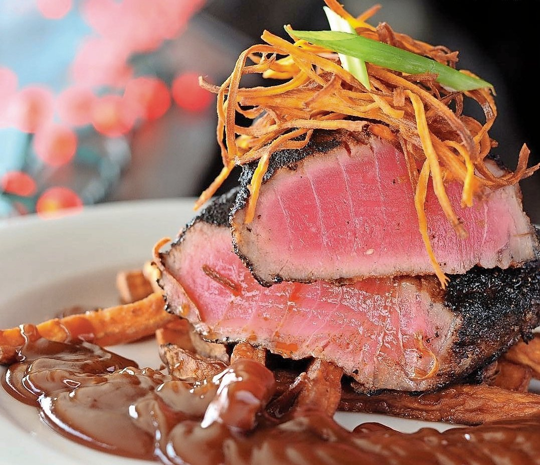 Blackened tuna is served with a sweet and spicy cayenne caramel sauce.