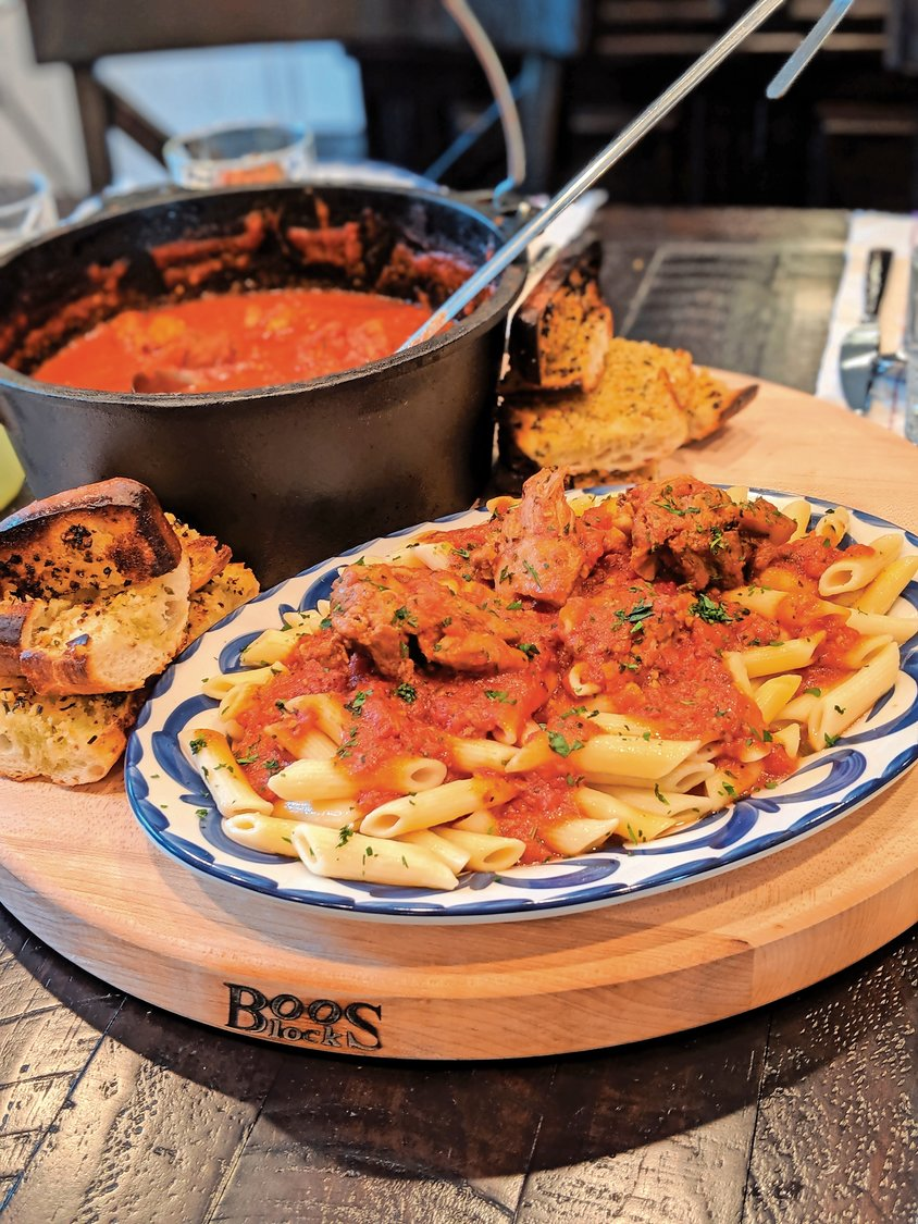 "An example of a ""revived"" dish: pasta with a vibrant meat sauce."