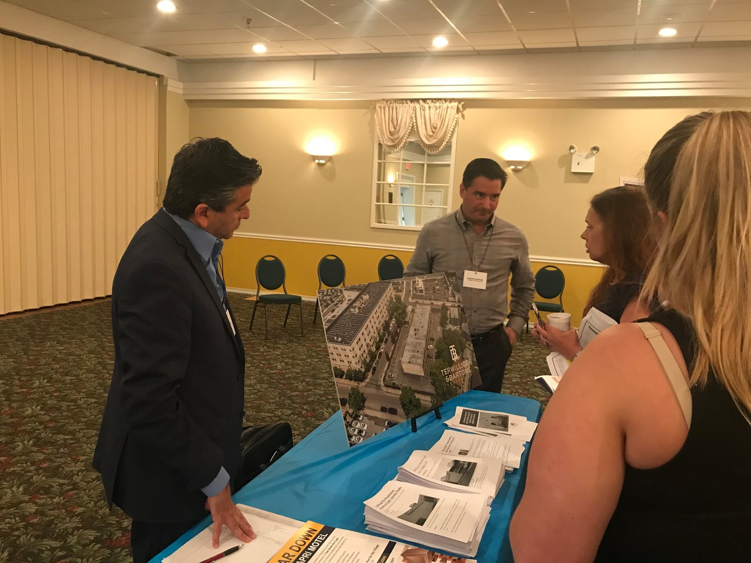 Developer Anthony Bartone, center, met with residents at an Aug. 20 open house to gather feedback about a potential rental apartment complex that he said he hoped to build at the site of the Capri Lynbrook Motor Inn.