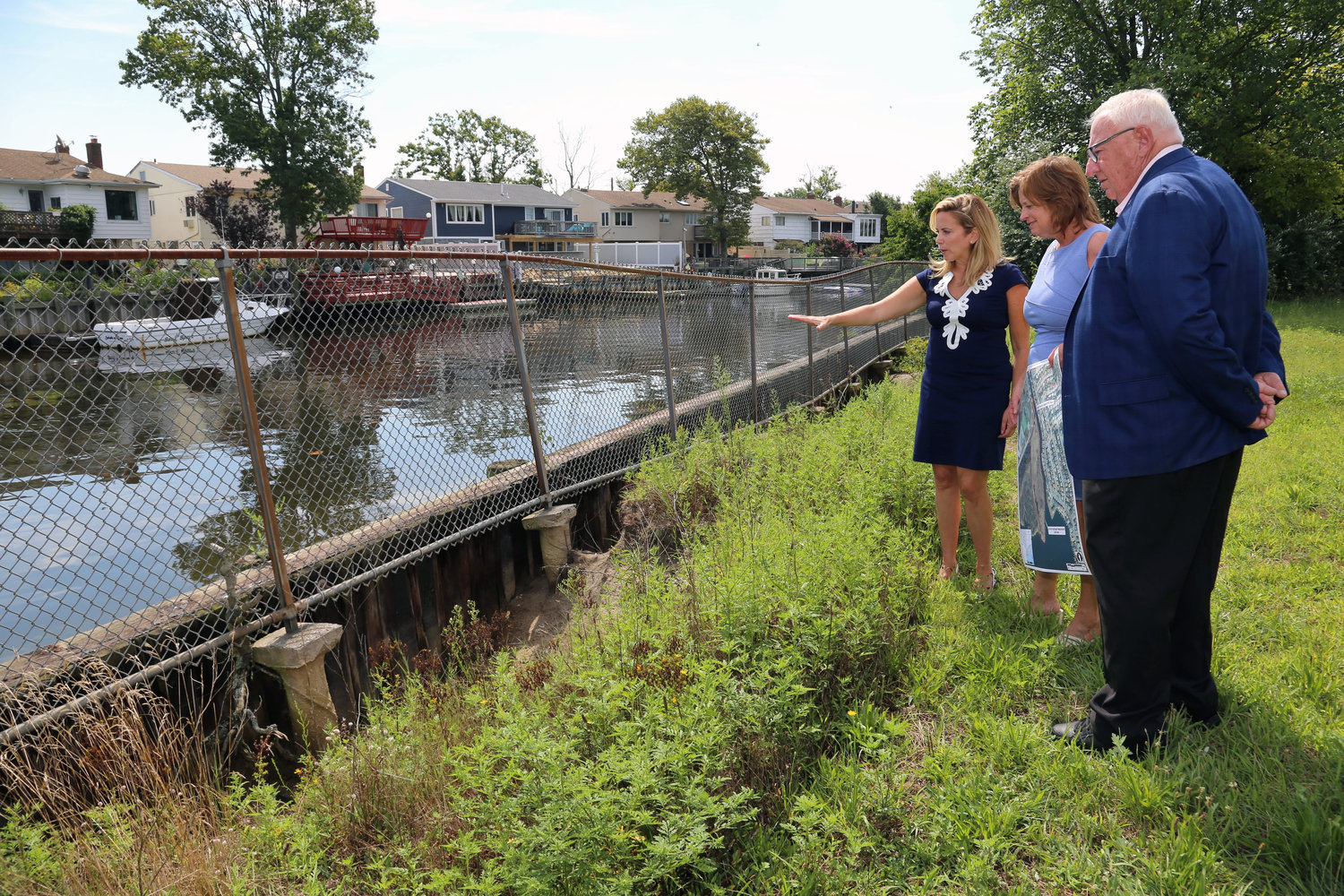Hempstead Town Supervisor Laura Gillen, left, Assemblywoman Judy Griffin and State Sen. John Brooks studied an area of Baldwin Harbor Town Park that will be fortified with storm protection features.