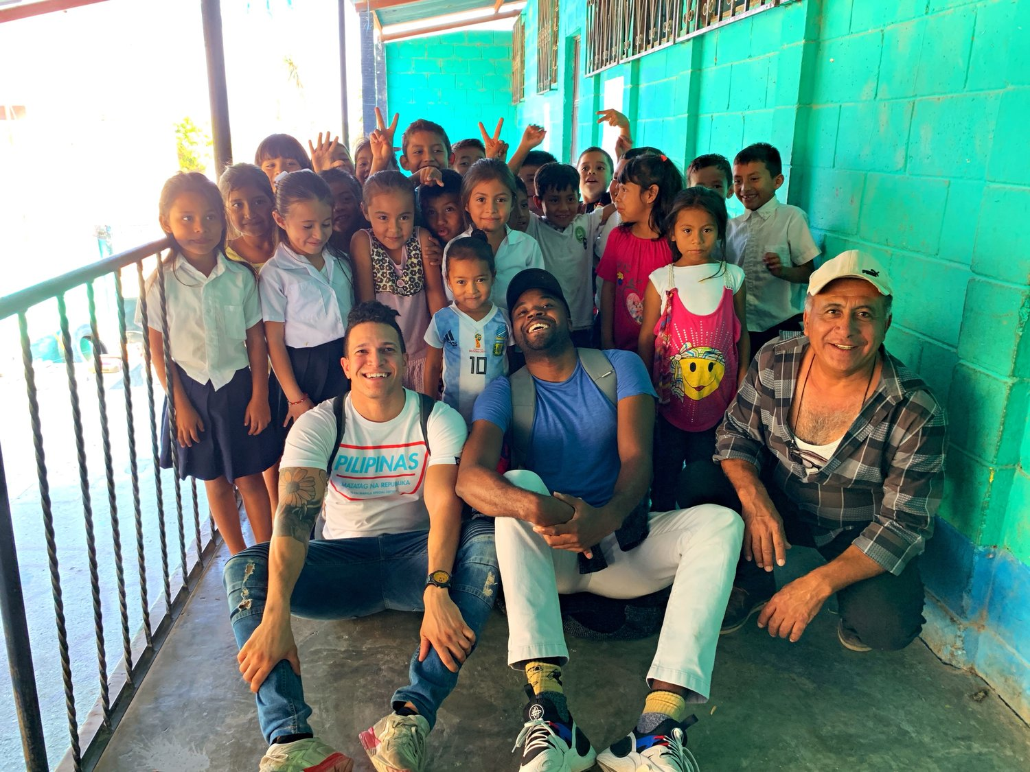 Craig Taylor, center, with children in Sanarate, Guatemala. His charity builds schools in poor areas around the world.