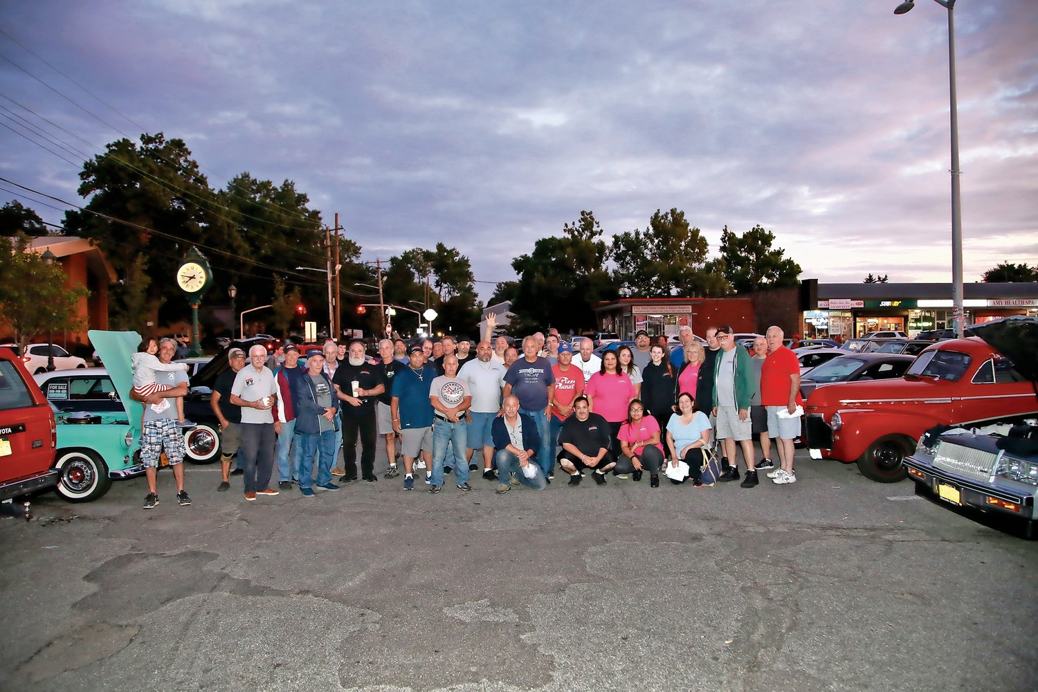 Members of the Empire Muscle Car and Dawgwood Boyz clubs gathered on Aug. 27 at the Best Market parking lot in Franklin Square as they do every Tuesday evening.