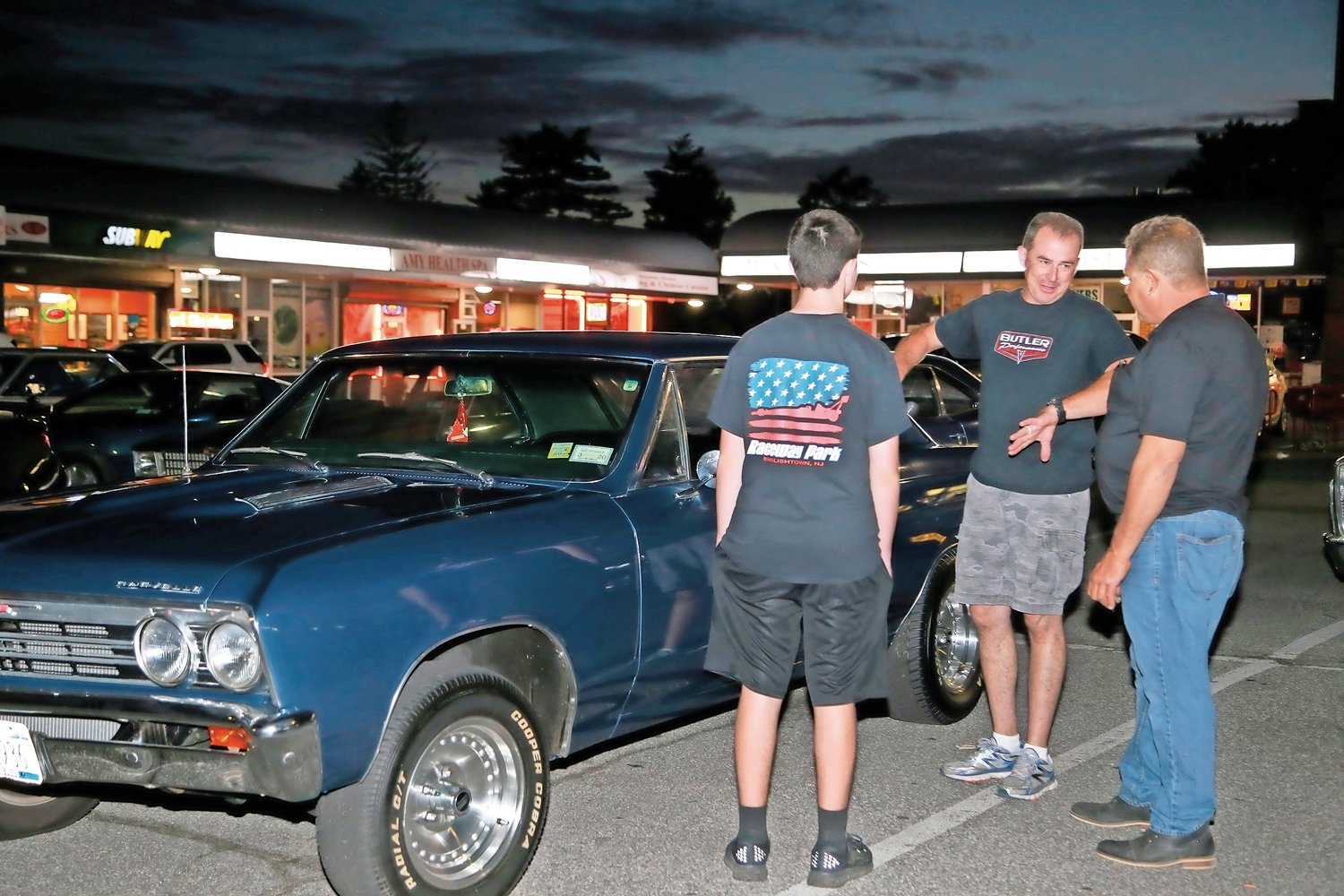 1967 Chevrolet Chevelle owner Sal Crino, right, chatted with Frank and Stephen Pulsifer about his car.