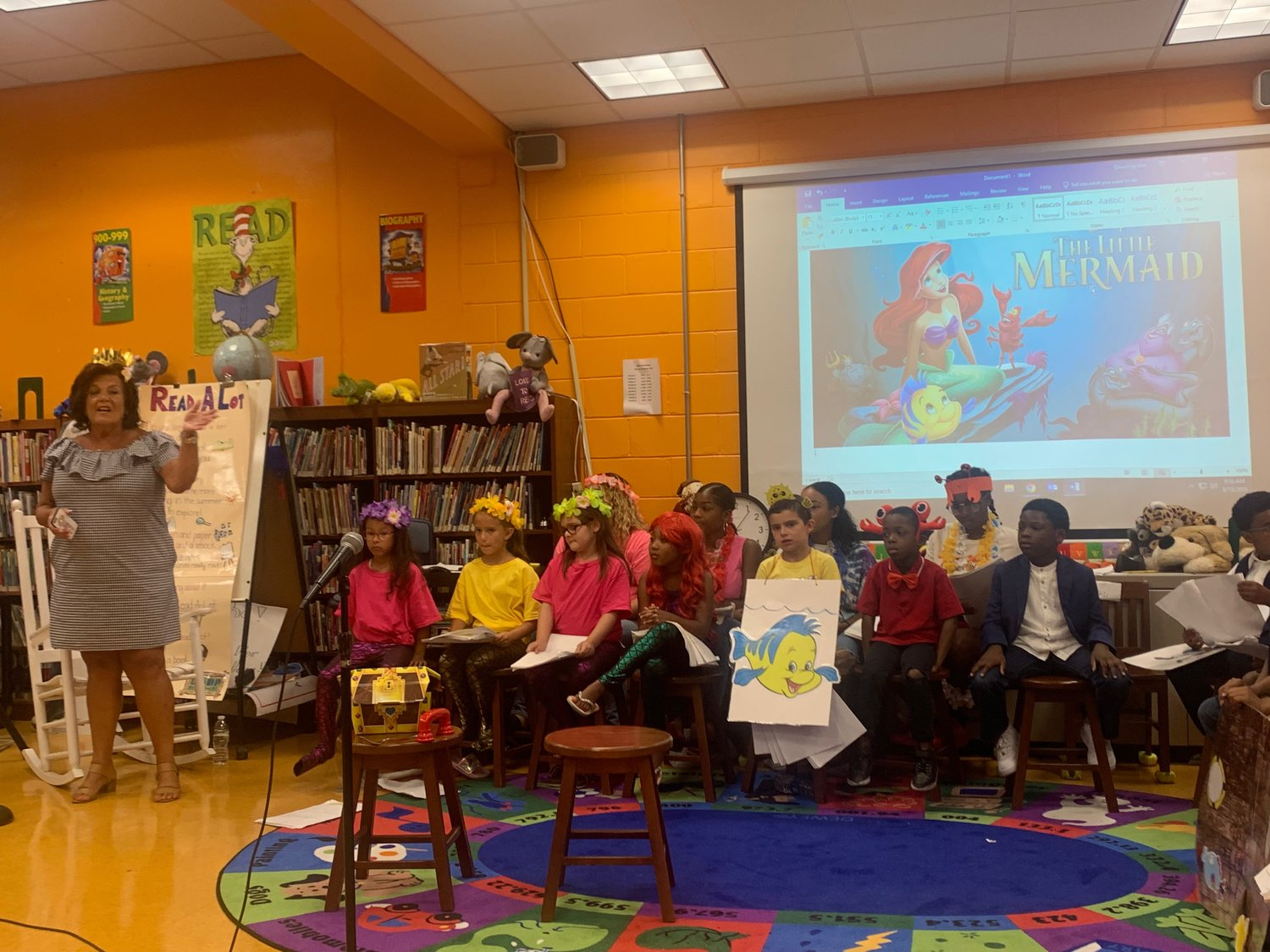 "Longtime Maurice W. Downing Primary School Student Council adviser Marguerite Robles recently performed ""The Little Mermaid,"" with Malverne students as part of Camp Read-a-Lot's Camp Challenge."