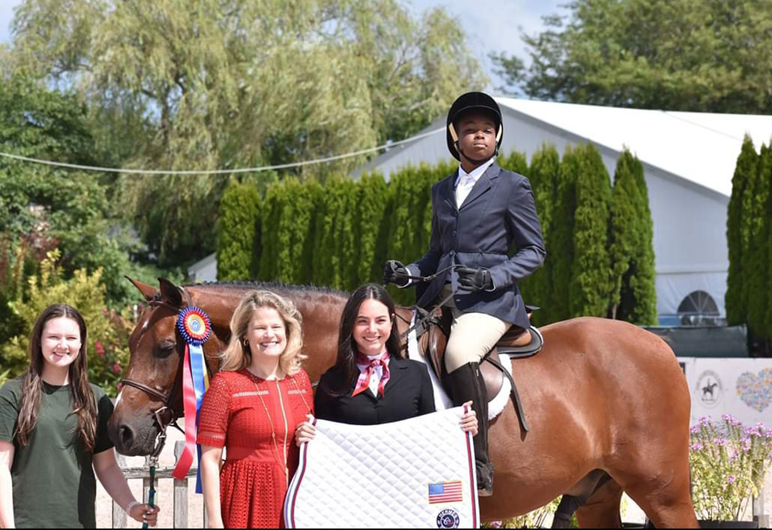Malverne High School tenth grader Isaiah Forte won the grand championship for the Long Island Horse Show Series for Riders with Disabilities championship finals on Aug. 26.