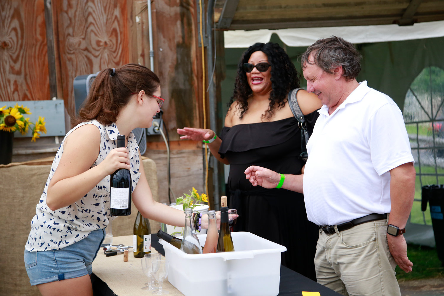Lizzie Papritz served up some red wine to Angela Philip and Hal Schwartz during Crossroads Farm's L.I. Food & Drink Sampling Event on Aug. 23.