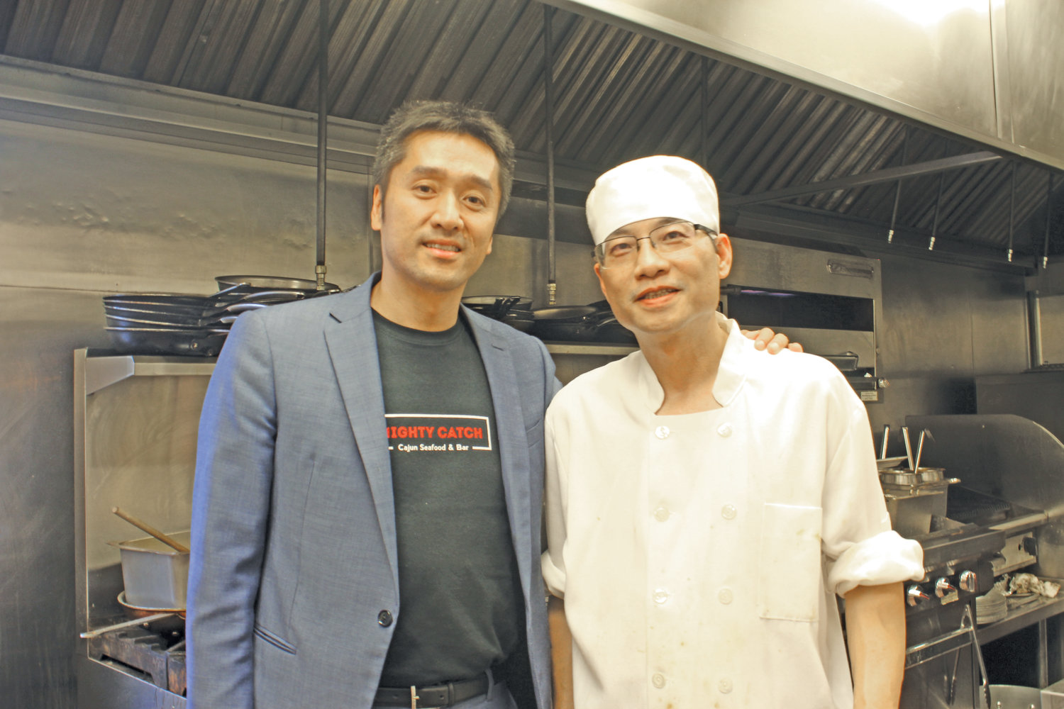 Tom Lau, left, and Wen Chen are the owners of Mighty Catch, a brand new restaurant on Long Beach Road in Oceanside.
