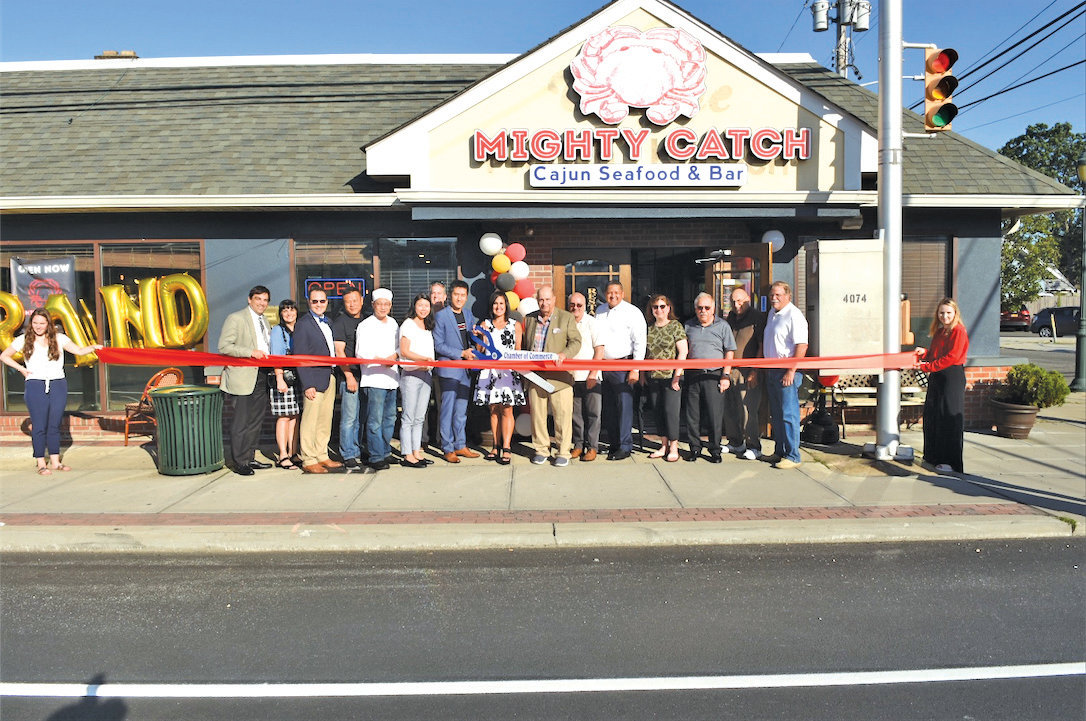Community members, including Town of Hempstead and Chamber of Commerce officials, joined Mighty Catch staff at a ribbon cutting on Aug. 29.