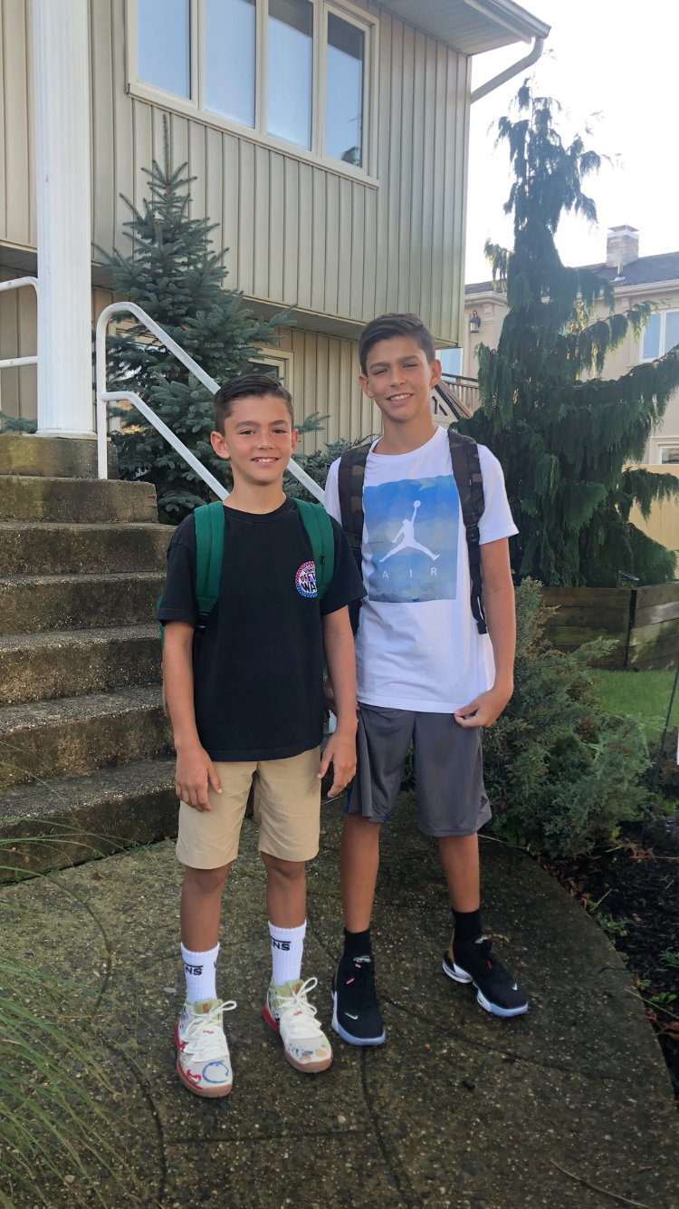 Seventh-grader Roman Perisa, left, and eighth-grader Marko Perisa returned to Oceanside Middle School.