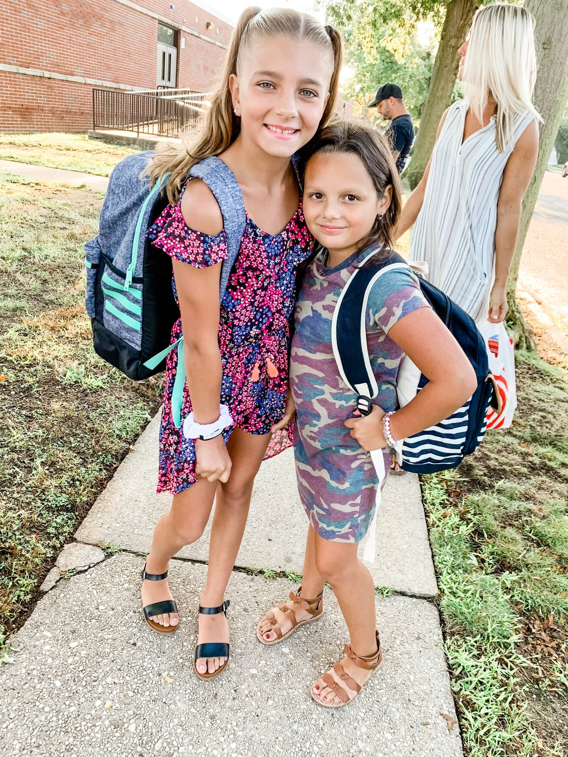 Isabella Marsicano, left, and Ava Tullo enjoyed the beautiful sunshine before their first day at School No. 8.