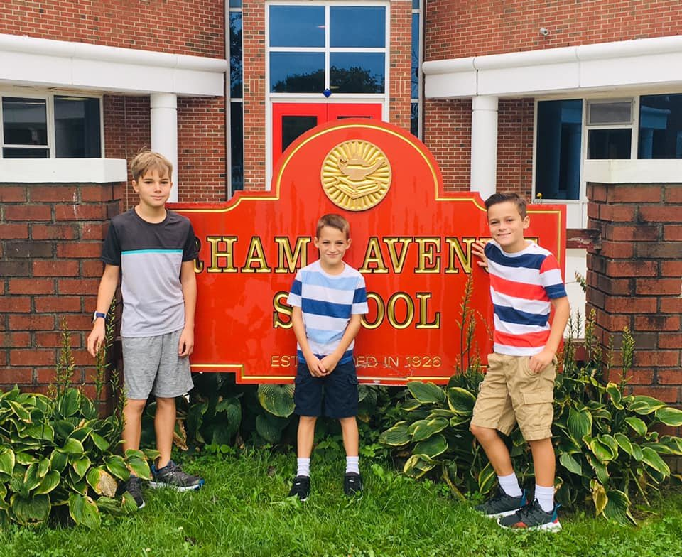 Justin (sixth grade), Jonathan (second grade) and Jack (fourth grade) Elliot returned to Rhame Avenue.