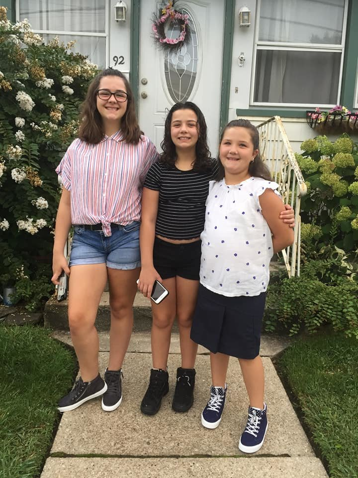 Emily Brown left, entering ninth grade at East Rockaway High School, Chloë Brown, center, entering sixth grade at Rhame Avenue and Molly Brown, entering third grade at Rhame, spent some time together before the first day of school.