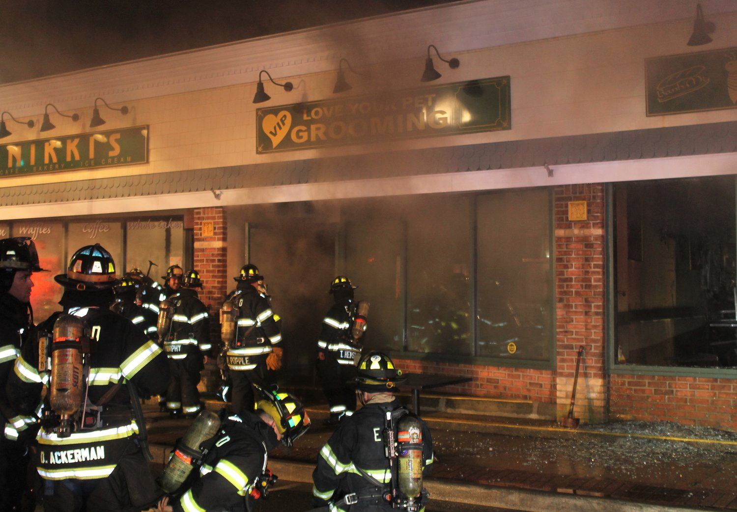 Initially sparked by a lightning bolt that struck the restaurant, the fire filled the pet-grooming store next door with smoke.
