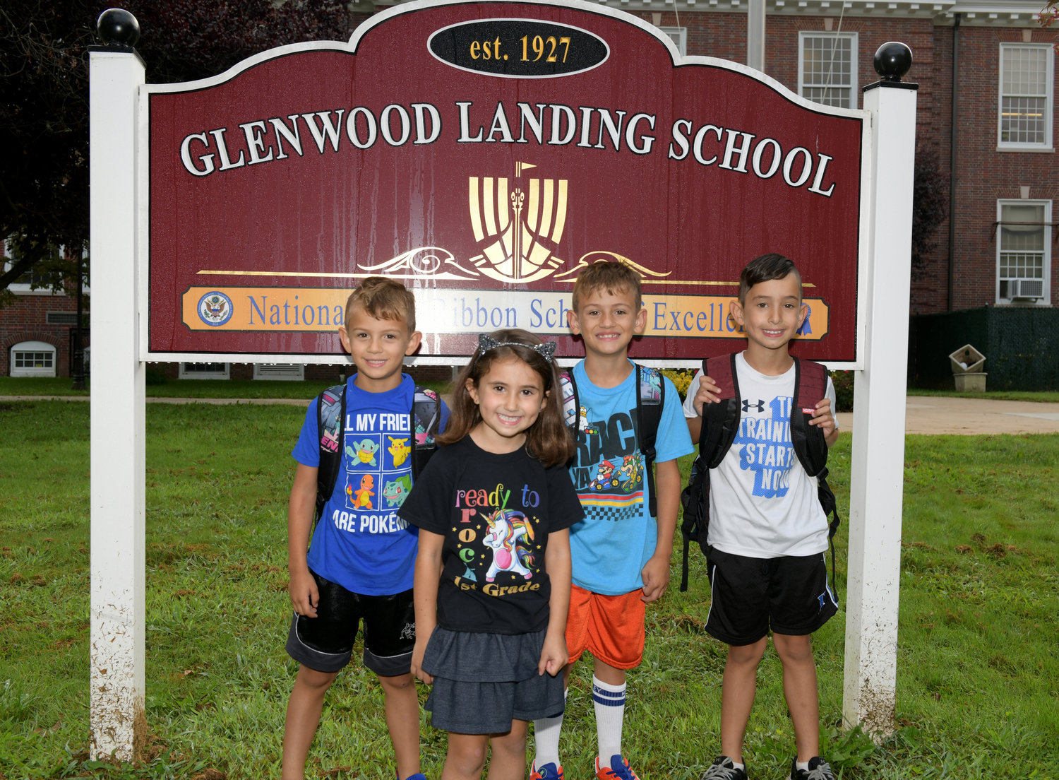 Joey, left and Riley Jerabek joined Christian and Nico Henley in the first day of school excitement.