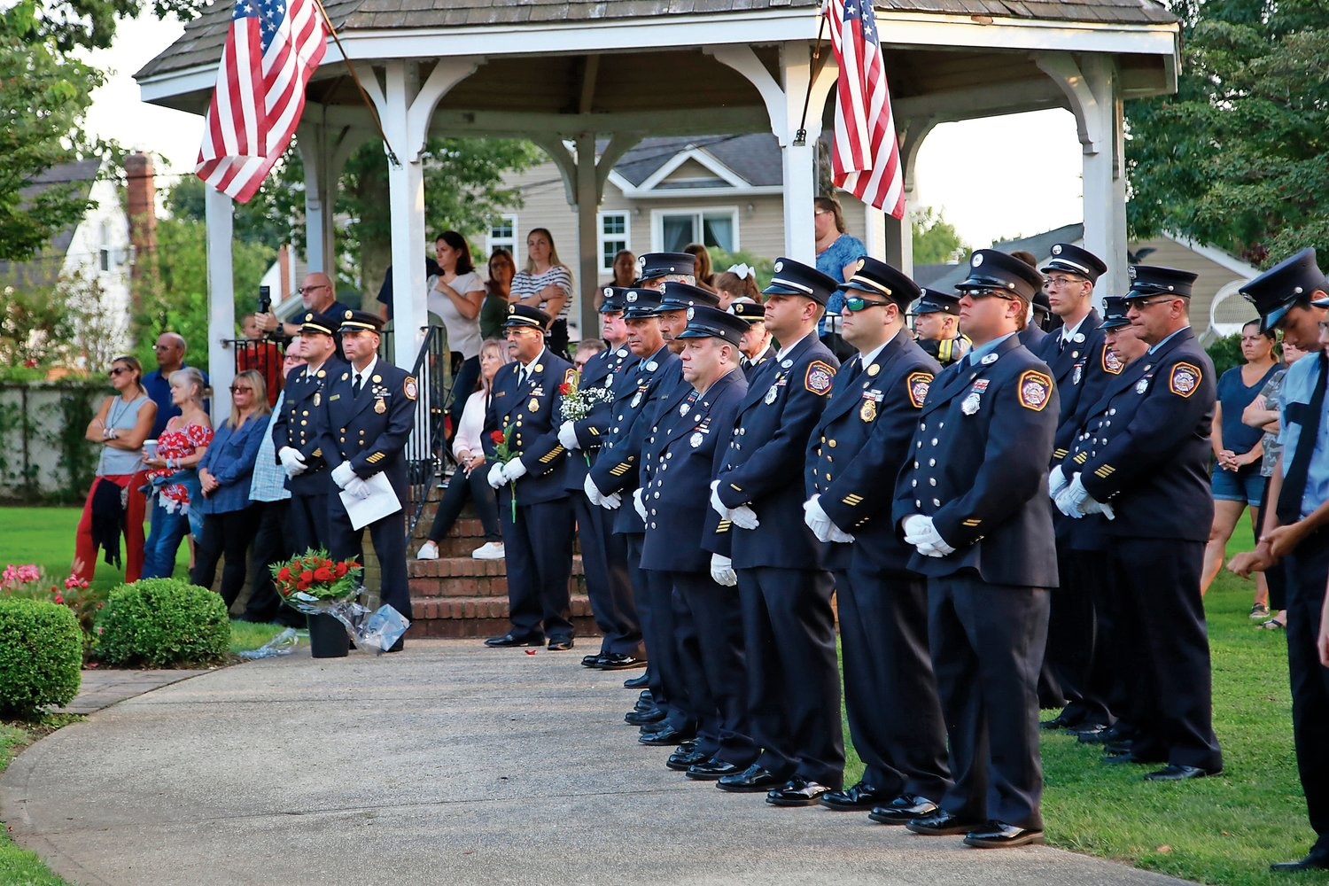 Members of the Franklin Square & Munson Fire Department listened as Ex-Chief John Novello and Chief John Salzman spoke about the lives lost in the Sept. 11 attacks.