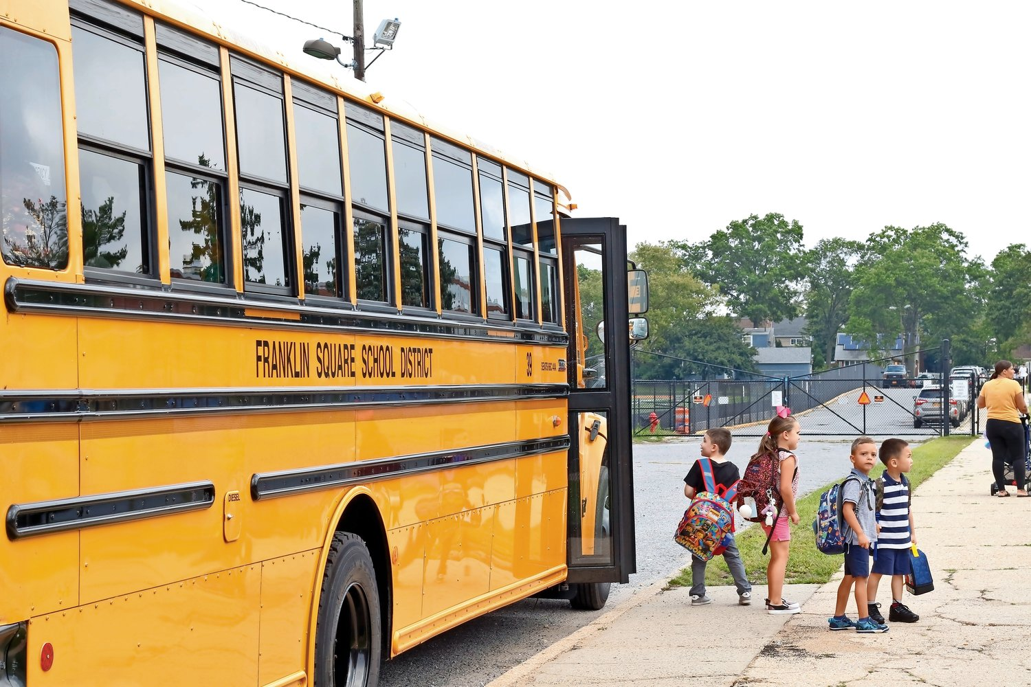 Students departed the bus, at right, on their first day of classes at Washington Street School on Sept. 4.