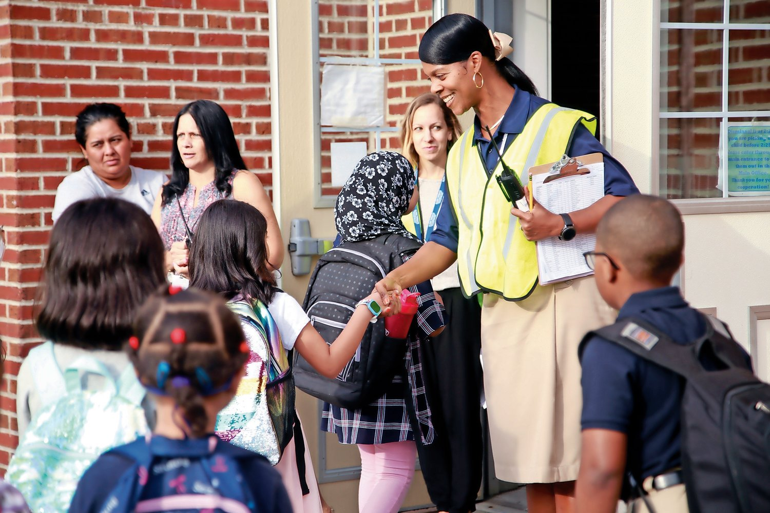 Principal Shawnee Warfield greeted second-graders on their first day back to the Alden Terrace School.