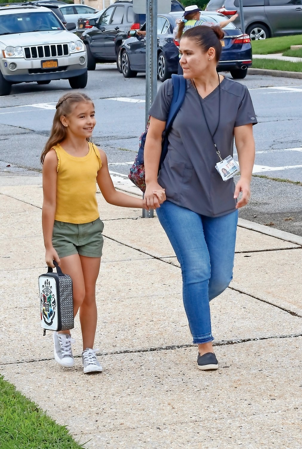 Second-grade student Lyvia Gonzalez, top right, walked to Washington Street with her mom Christina.