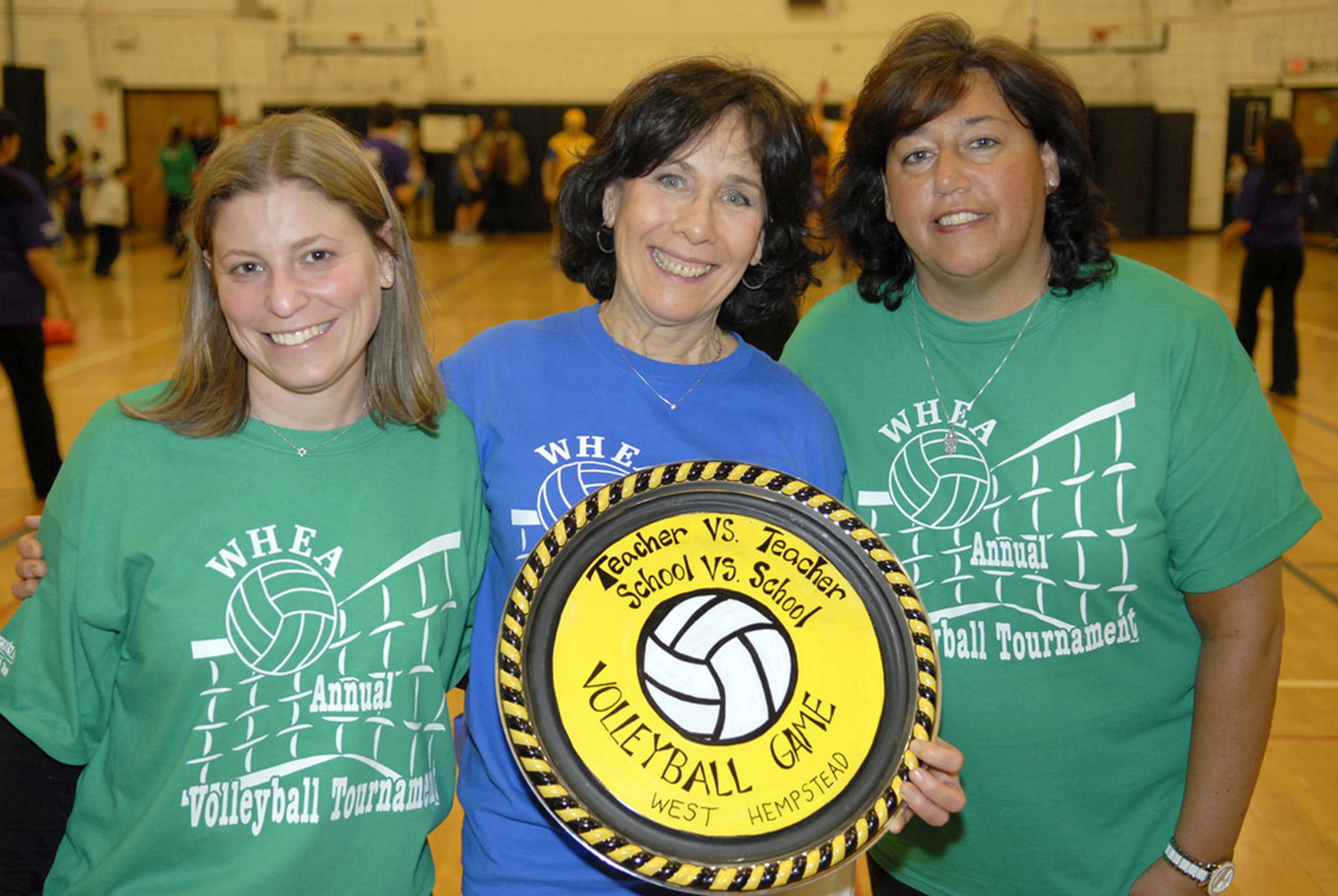 Barbara Hafner, center, along with elementary school teachers Stacey Schwartz, left, and Jill Sirlin, hosted a volleyball fundraising competition in 2012.