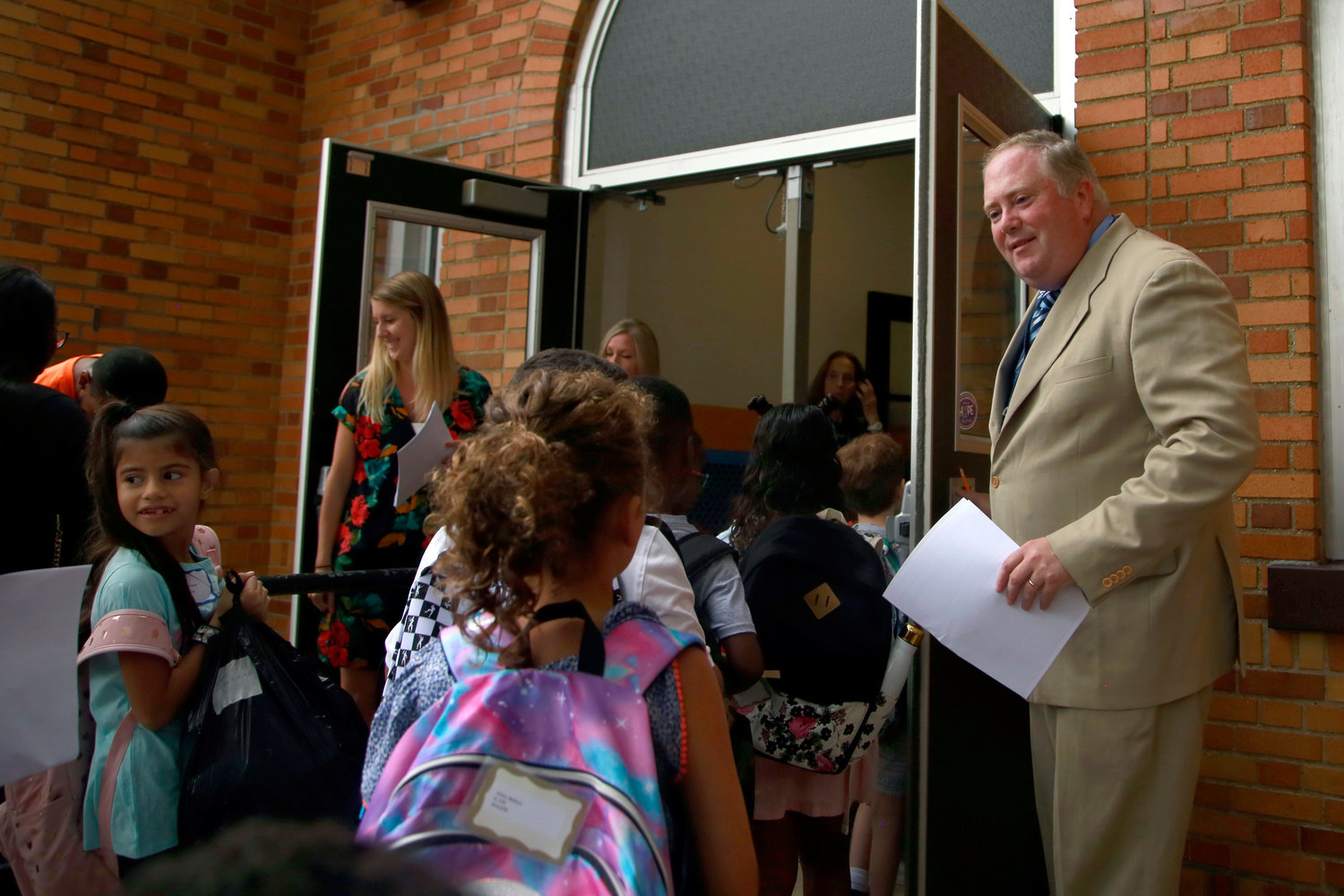 Maurice W. Downing Principal Ed Tallon greets the students on their first day of school.