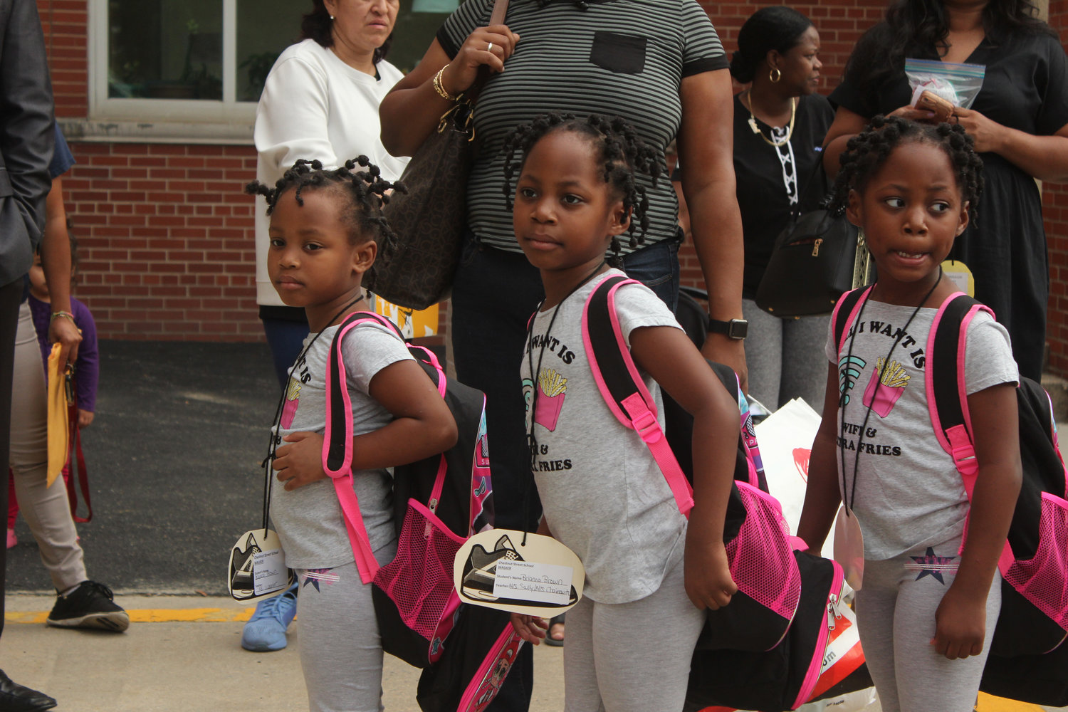 Triplets Bianca, left, Brianna, and Brineka Brown wore matching outfits.