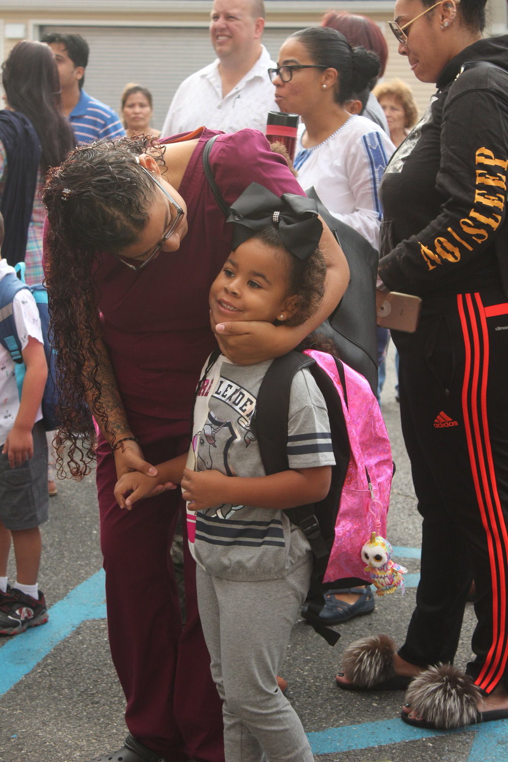 Felicia Reyes gave her daughter, Nyla, a hug and some words of encouragement.