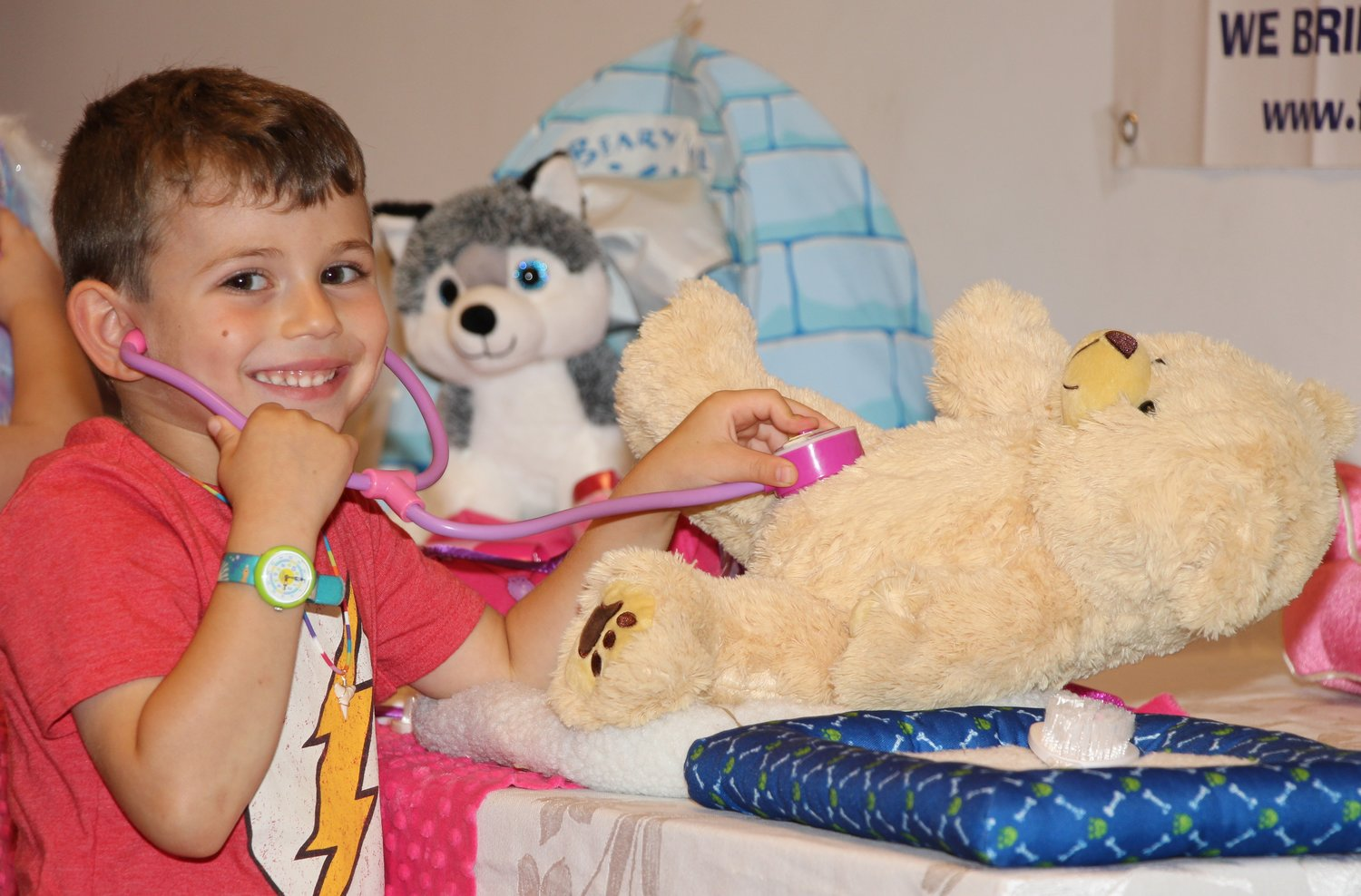 Five-year-old Nathan Smith was one of several children to build a bear at the West Hempstead Public Library for Grandparents Day last Sunday. Nathan gave his bear a checkup before he took it home.
