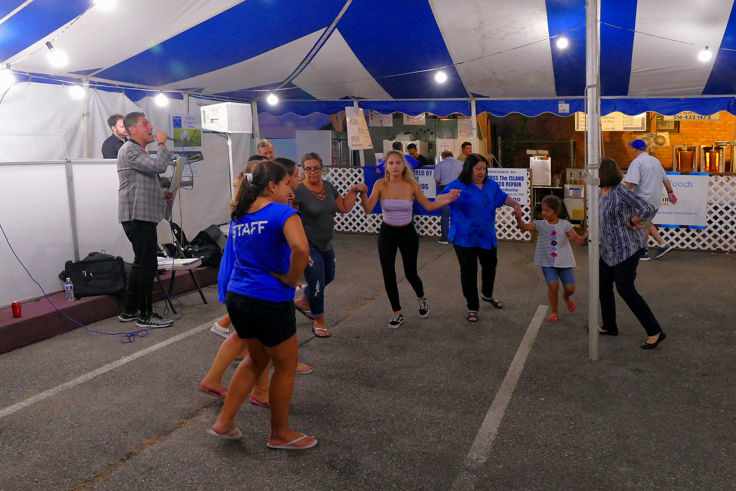 Staff members and festival guests felt the urge to sing and dance under the colorful tent.