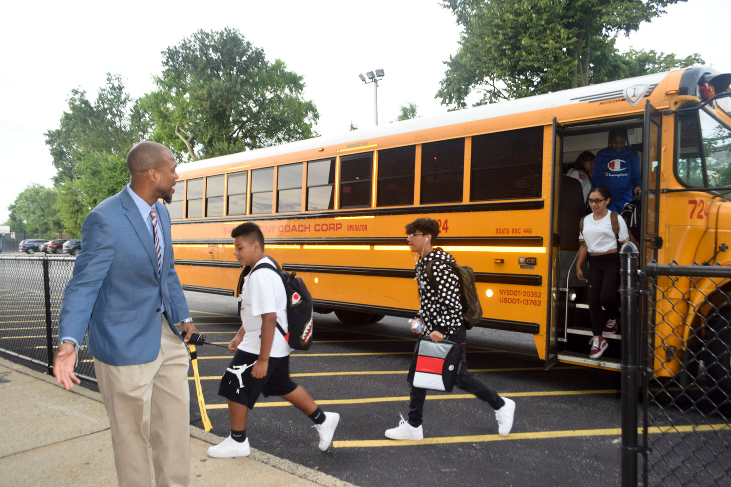 : Lawrence Middle School Principal Willis Perry led the way to a new school year for students on Sept. 5.
