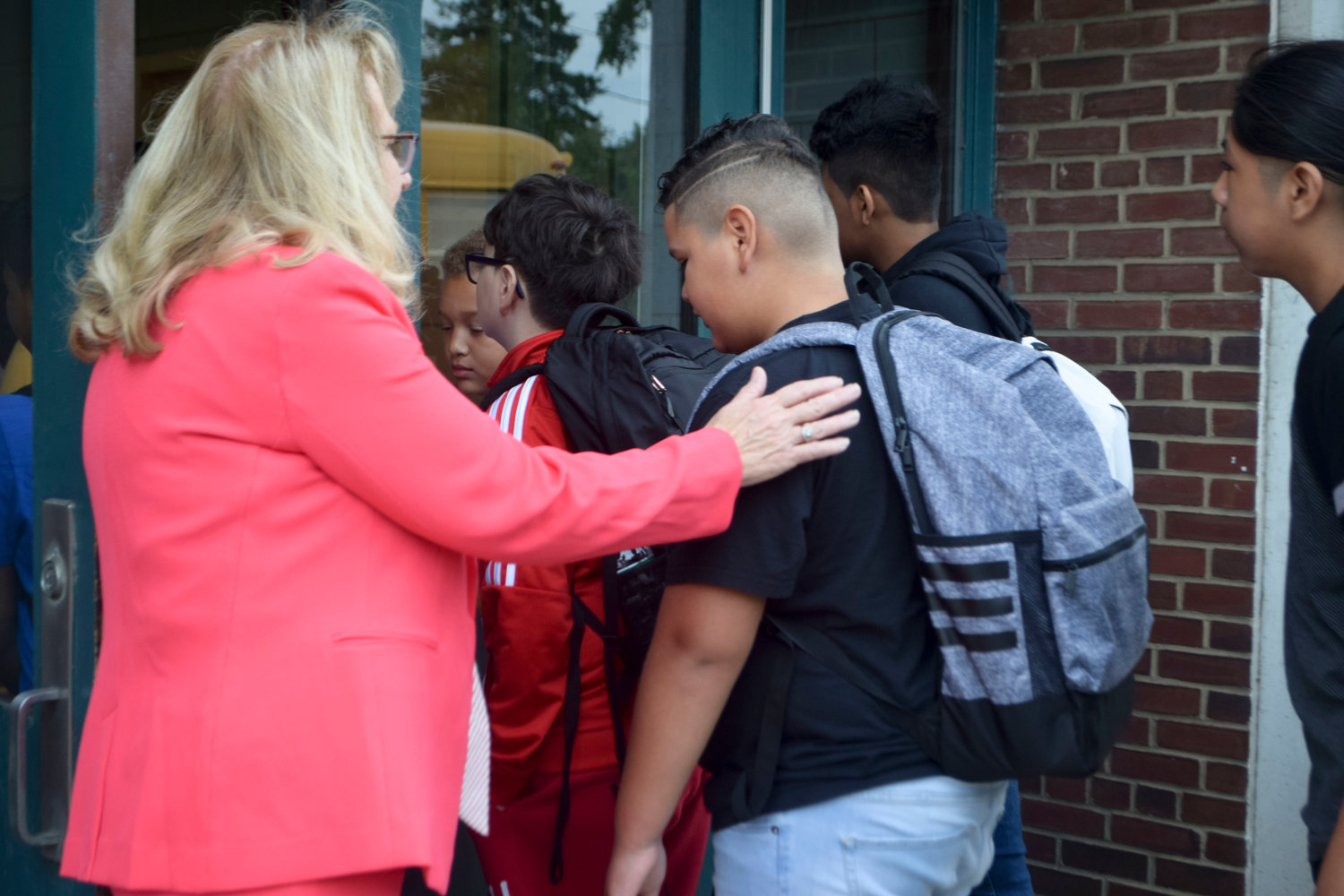 Lawrence School District Superintendent Dr. Ann Pedersen lent her personal touch to greeting students at the middle school on the first day.
