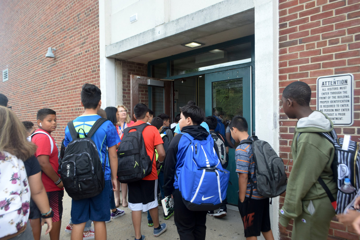 With the de rigueur backpacks attached, middle school students filed into the building with Superintendent Dr. Ann Pedersen at the door.