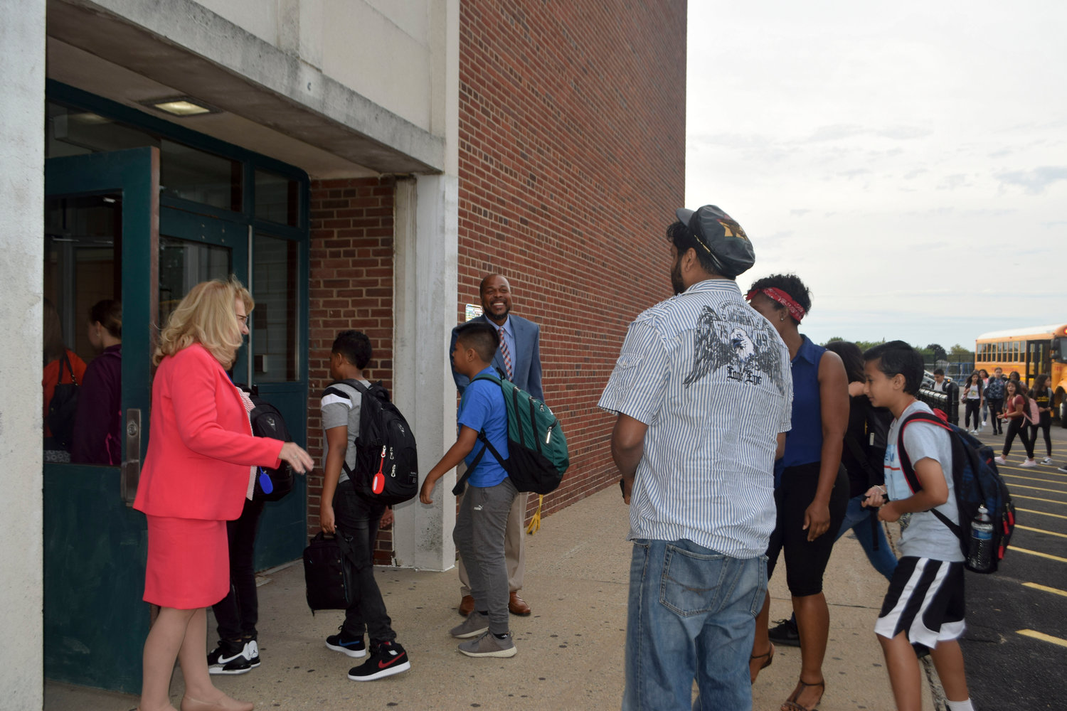 Middle school Principal Willis Perry was all smiles and Superintendent Dr. Ann Pedersen was at the door as both greeted parents and students on the first day of school.