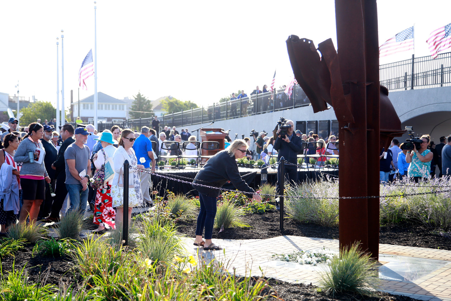 Mourners lined up to place white carnations around a 30-foot-tall steel beam that was recovered from the World Trade Center site at the Town of Hempstead 9/11 memorial in Lido Beach.