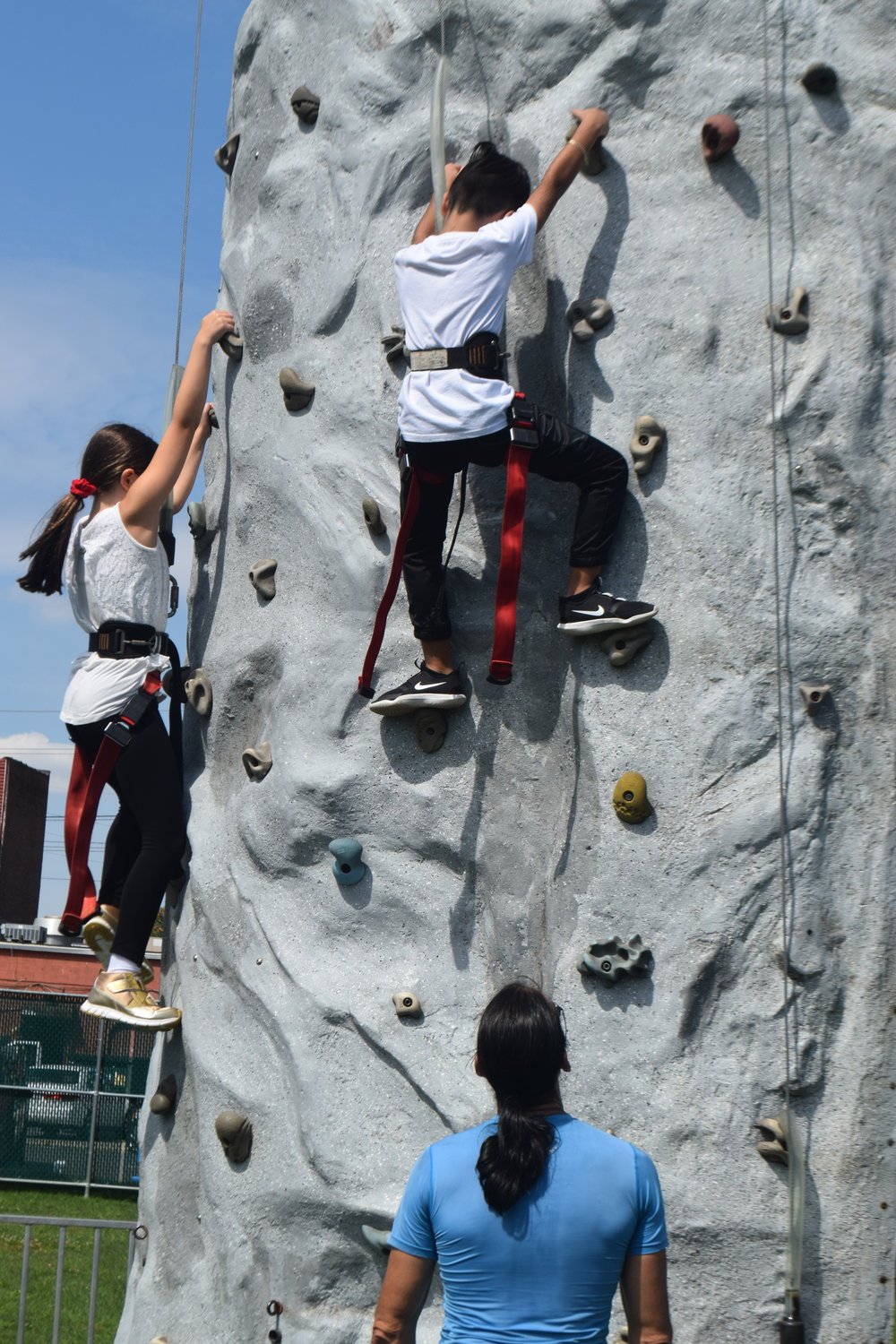 Leia Cohen, 10, and Benjamin Abramov, 7, showed their climbing skills on the rock wall.