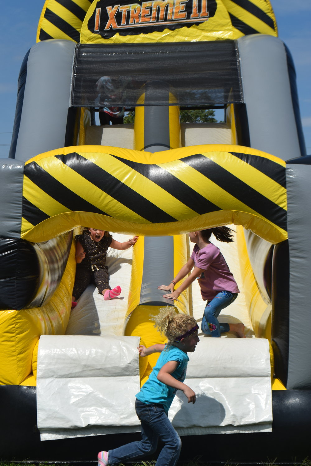 The inflatable slide appeared to be a fun attraction for the children.