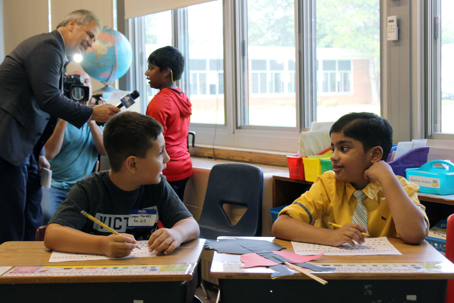 Mahdi, right, and his friend Logan Morales settled into their new desks in Allison Brafman's fourth-grade class.