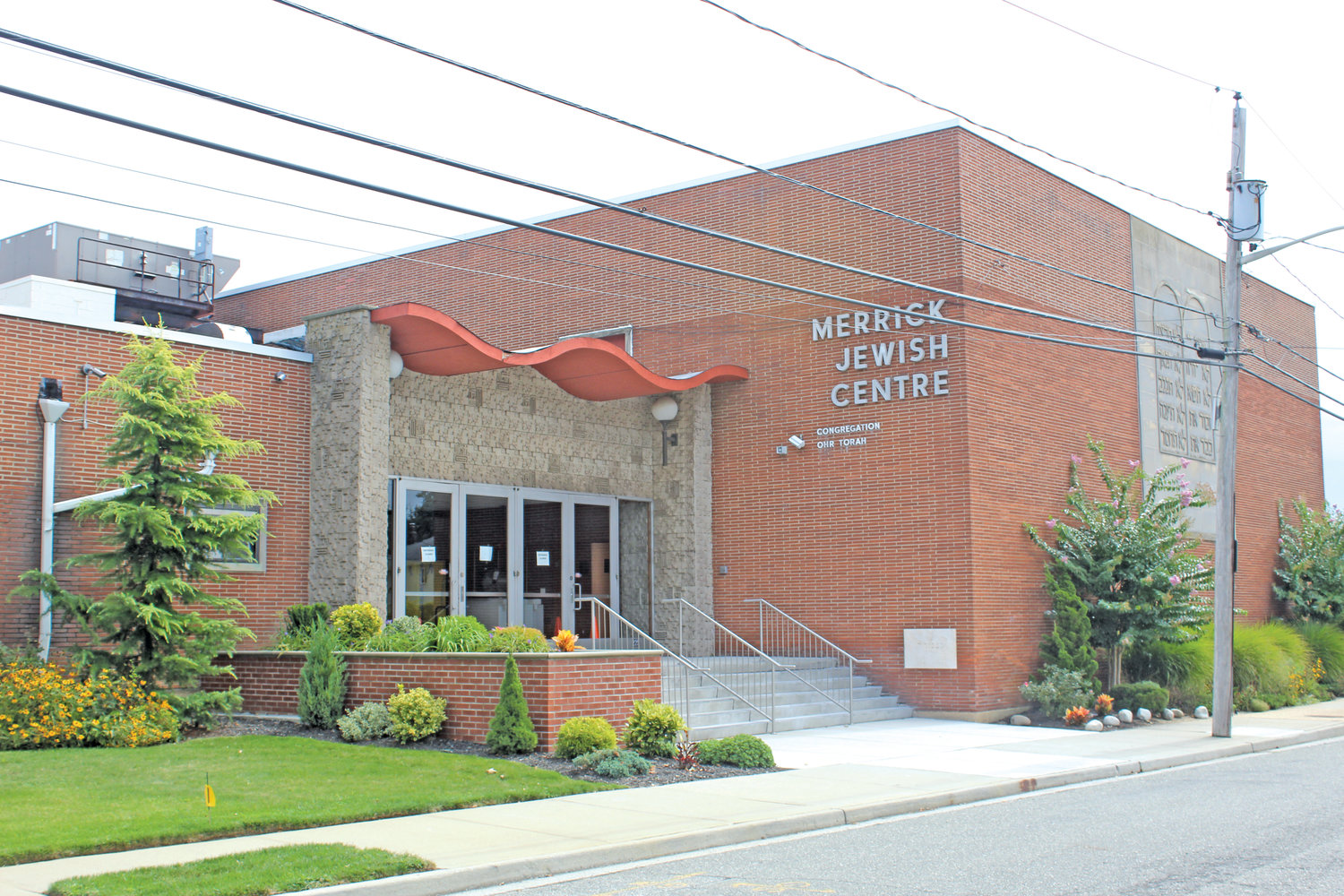 The Merrick Jewish Centre is beefing up its security, including the addition of armed guards and the installation of an intercom system at entrances.