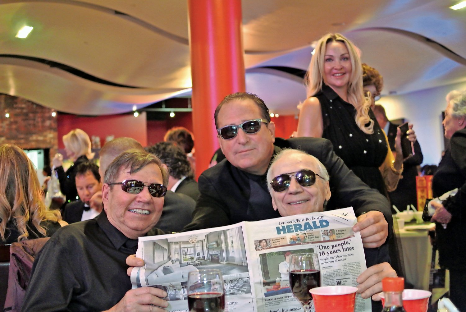 Mark Goldman, center, caught up on the local news at the 2019 Action On Film International Film Festival in Las Vegas in July. With him were screenwriters Harold Brown, left, and Matt DeGennaro.