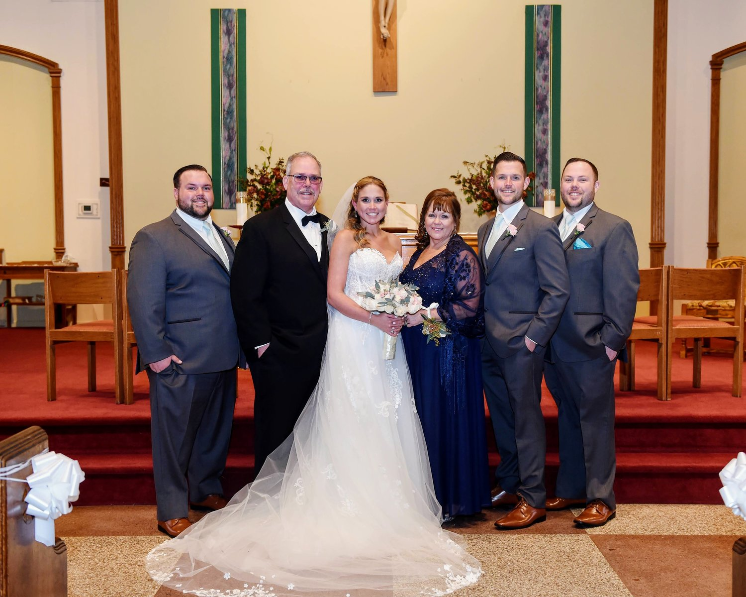 The Biens have volunteered in Lynbrook for many years. Above, Jamie on her wedding day with, from left, Dylen, Lawrence, Kathy, Kyle and Scott.