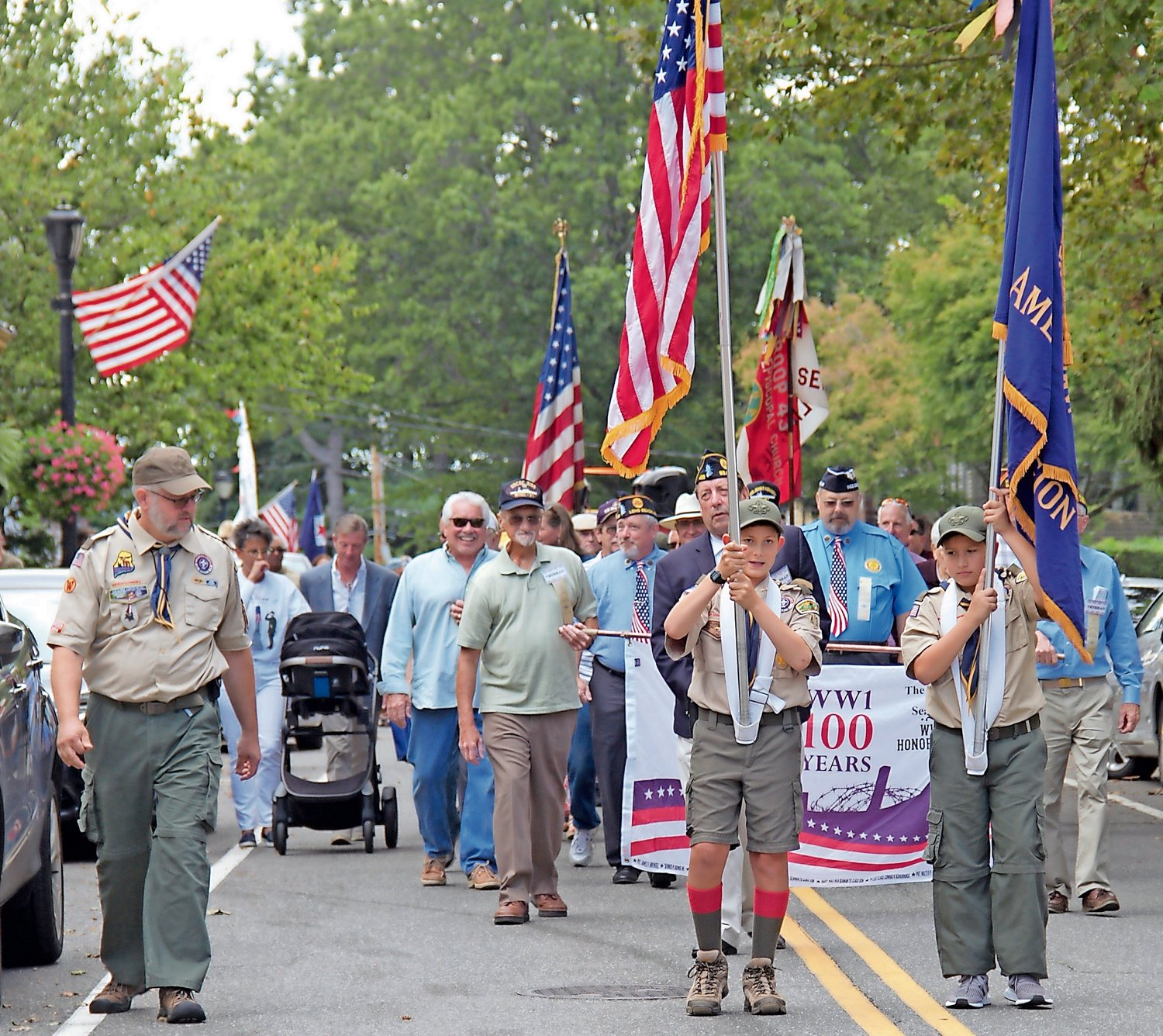 Boy Scout Troop 43 members Jared White, 12, front left, and Paolo Romito, 11, front right, led the parade.