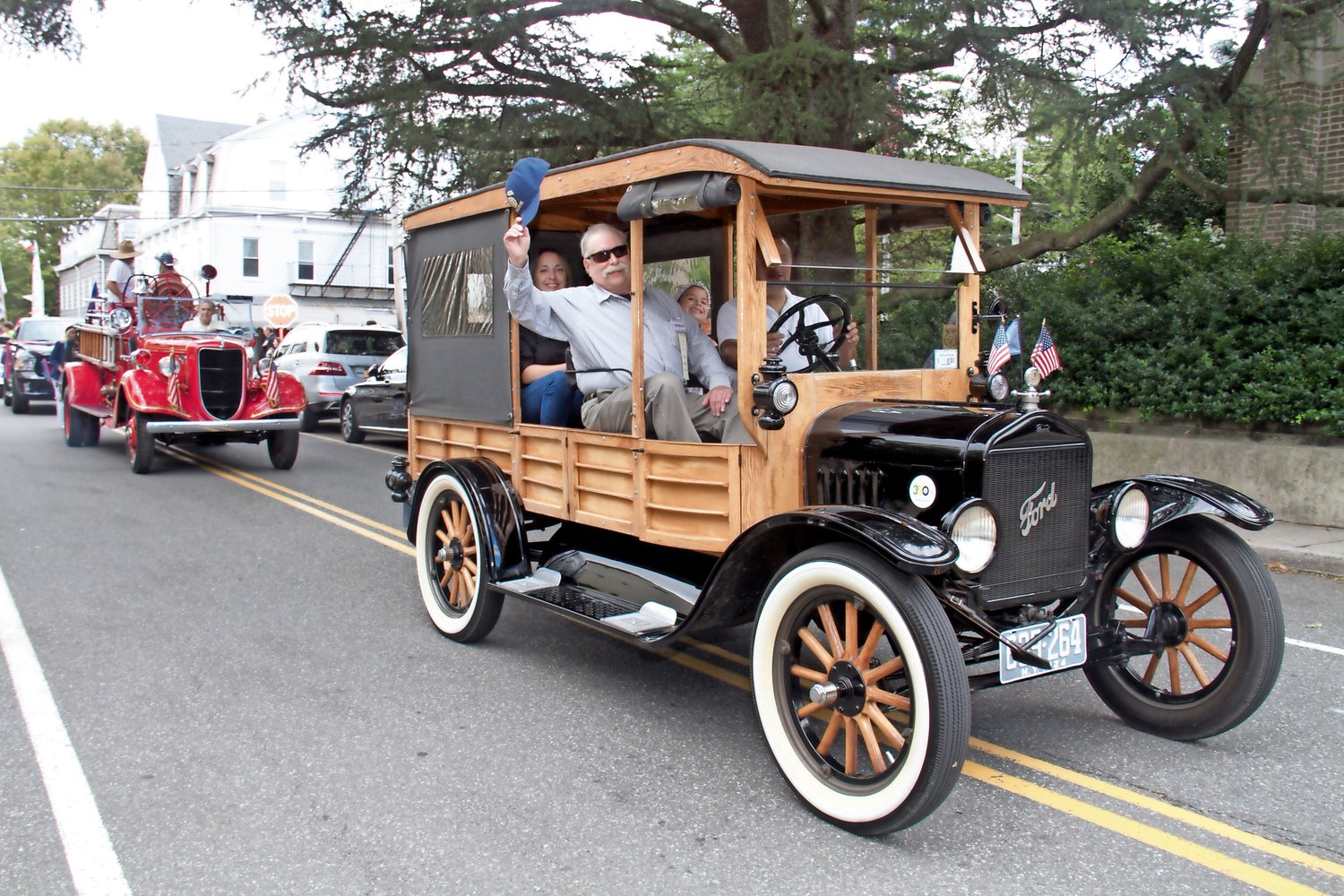 Veteran James Foote rode in an antique Model-T Ford.